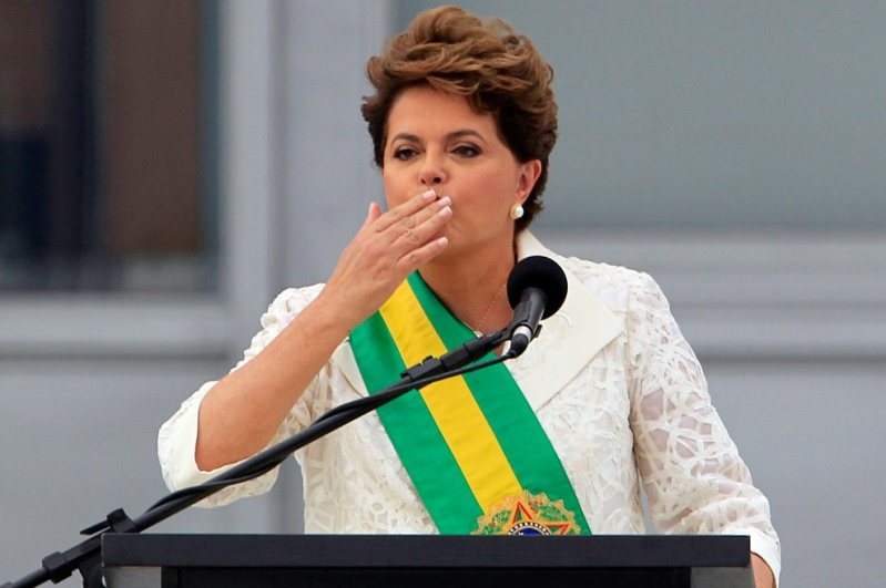 Brazil's President Dilma Rousseff blows a kiss to the public while giving a speech in front of Planalto Palace in Brasilia