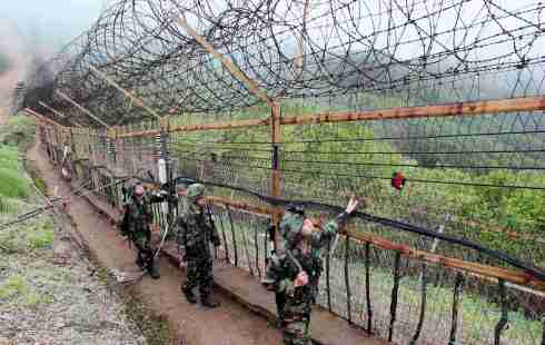 South Korean soldiers patrol along military fence near DMZ separating South Korea from North Korea in Yanggu